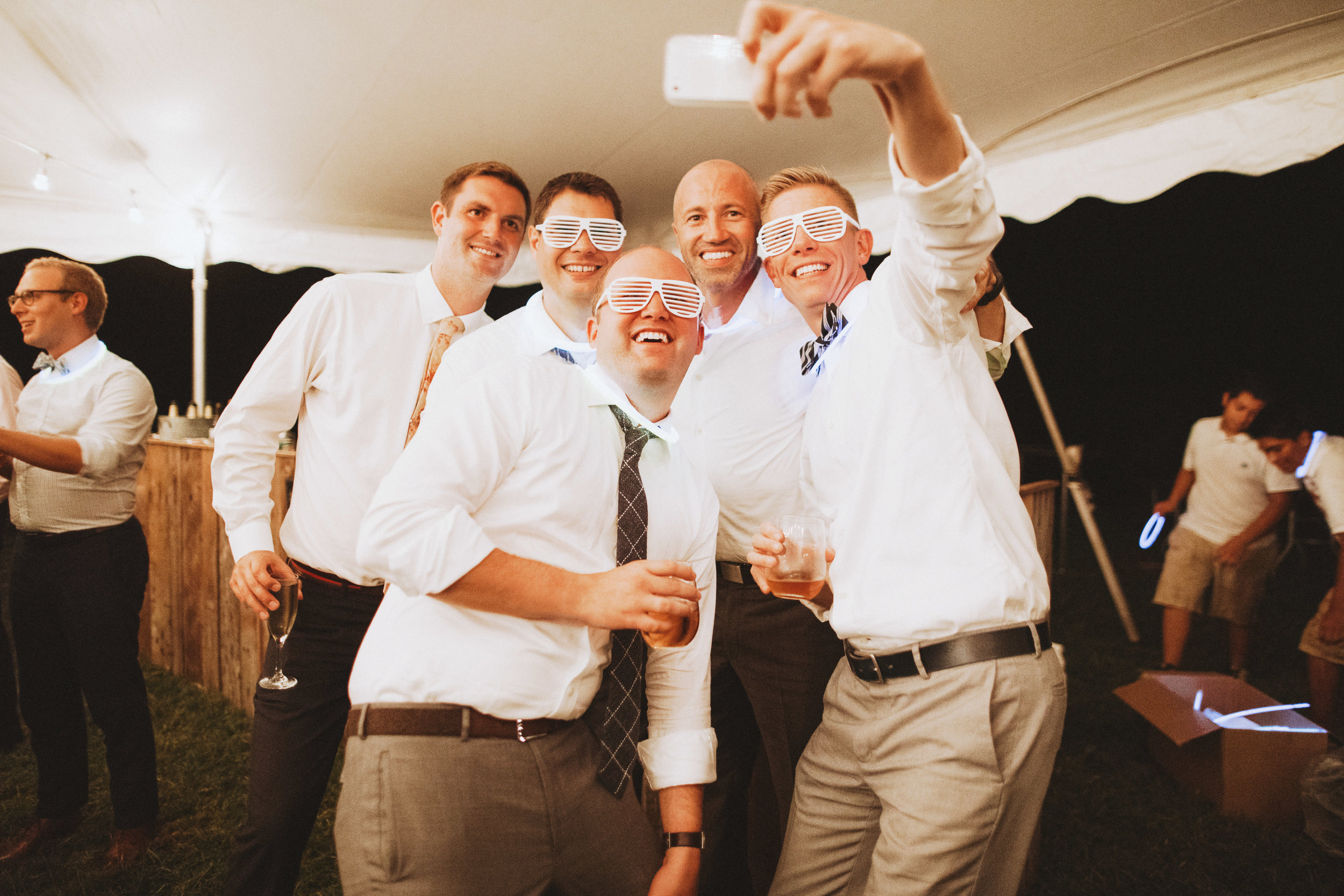 groomsmen and grooms in silly glasses