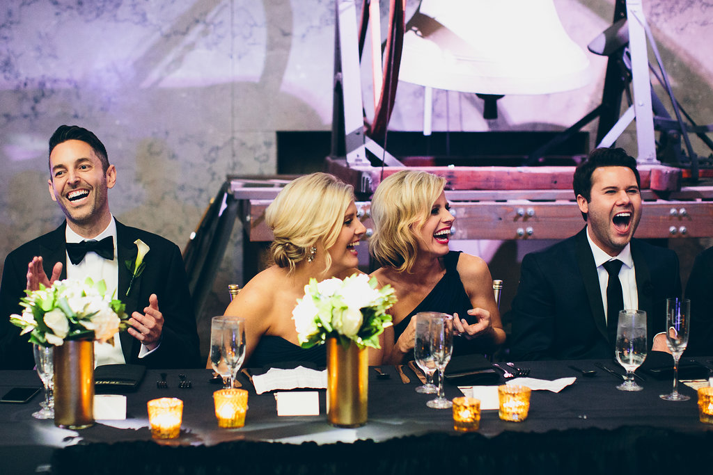 Wedding party laughter at an elegant Black tie wedding photographed by Cassandra Zetta.