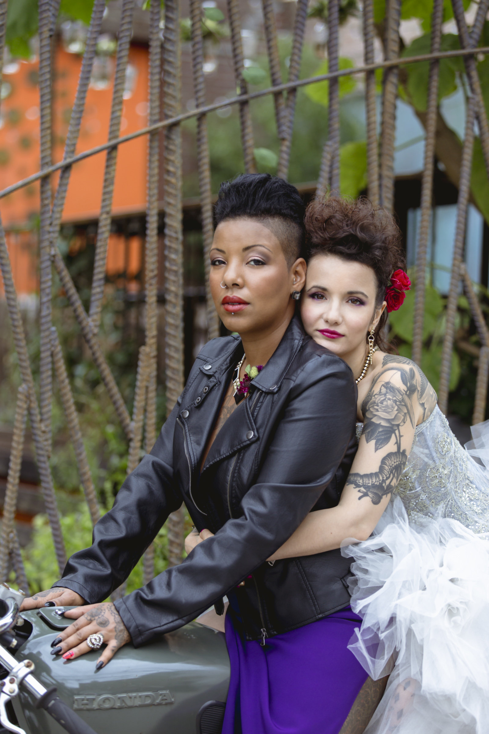 Two brides on a motorcycle