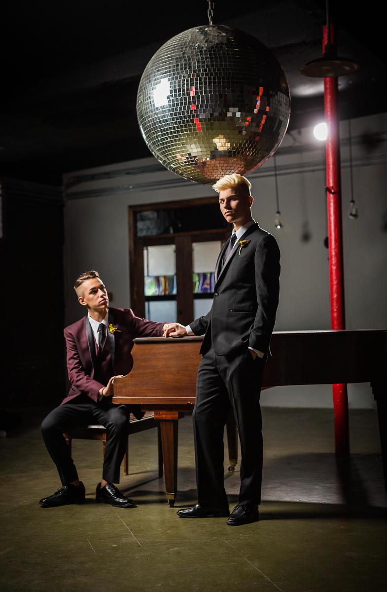 same-sex wedding with a disco ball