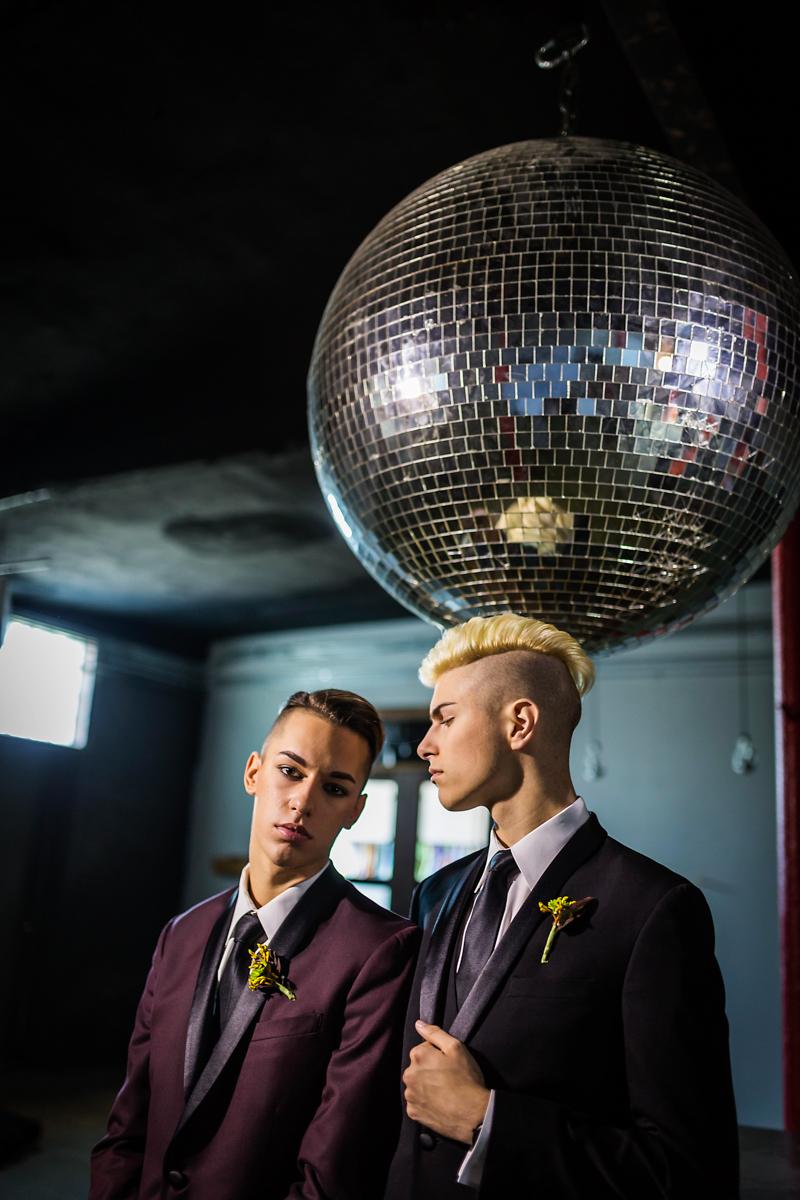 Same-sex couple at their wedding with a disco ball