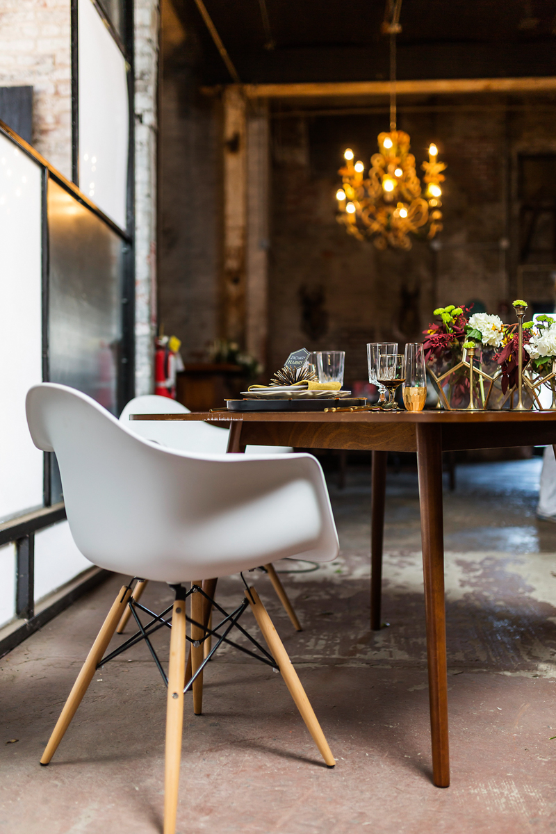Mid-century modern chair at a wedding by Mad Hatter Vintage Rentals