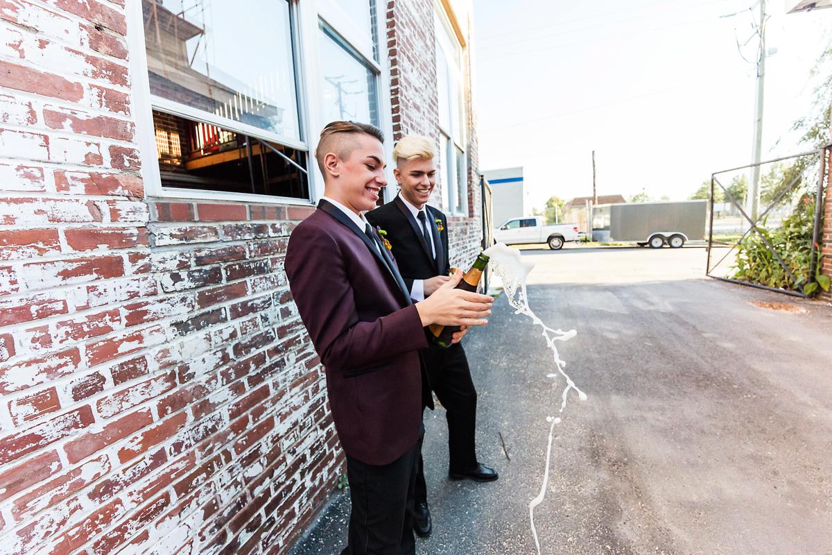same-sex wedding champagne pop