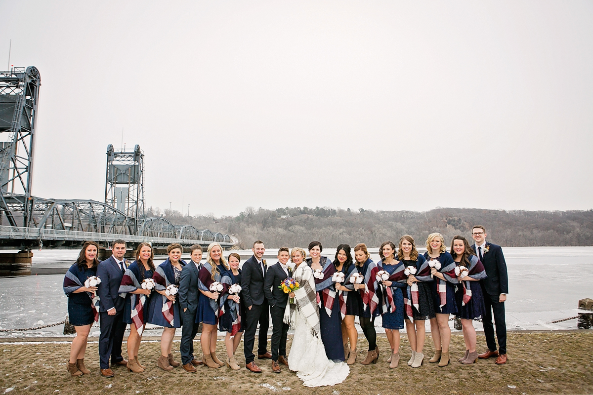 mixed gender bridal party in the winter, with blanket wraps