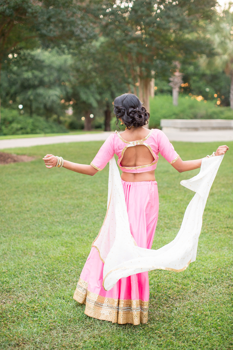 open back pink and gold indian wedding gown