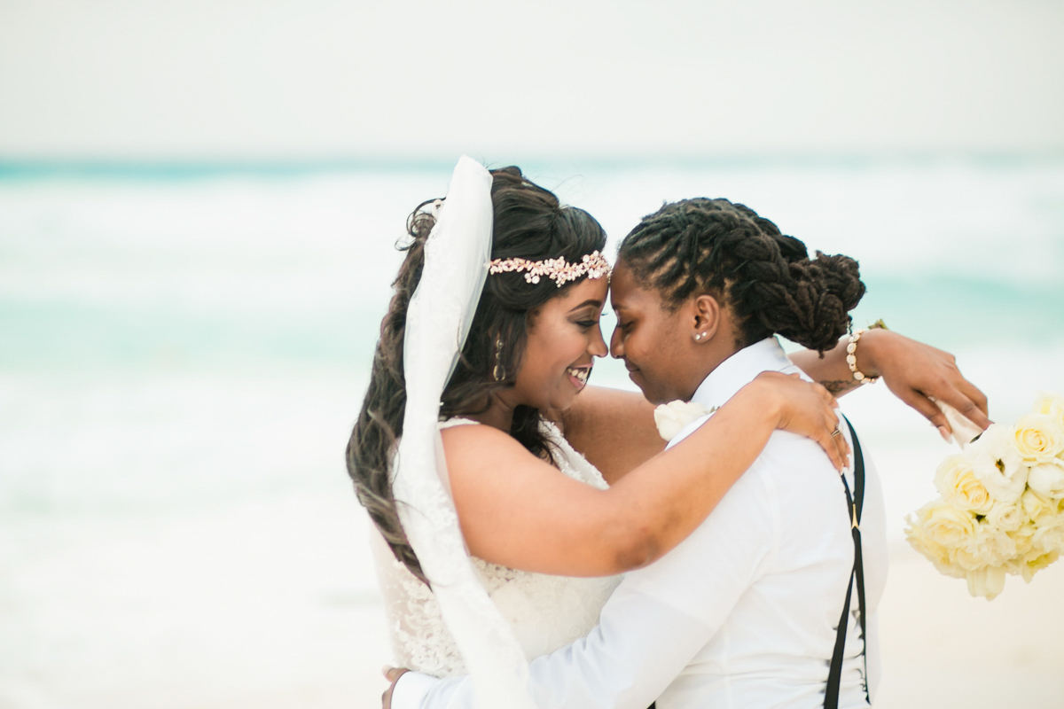 same sex wedding portraits on a beach in mexico