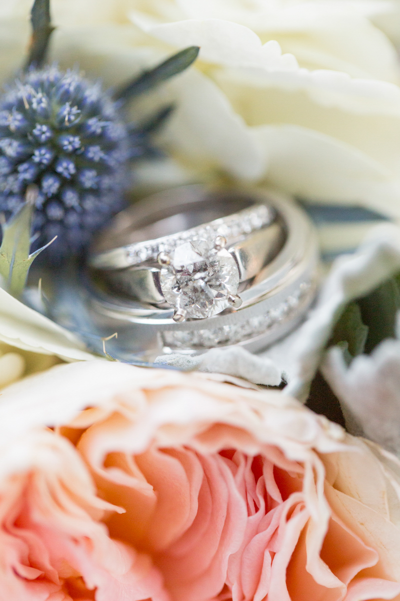 wedding bands posed on a bridal bouquet