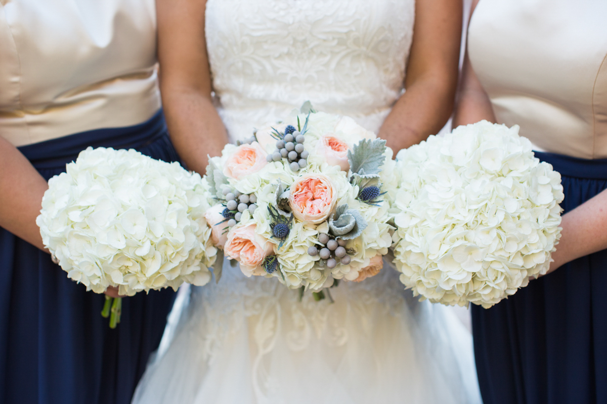 bride and bridesmaids bouquets featuring hydrangea and roses