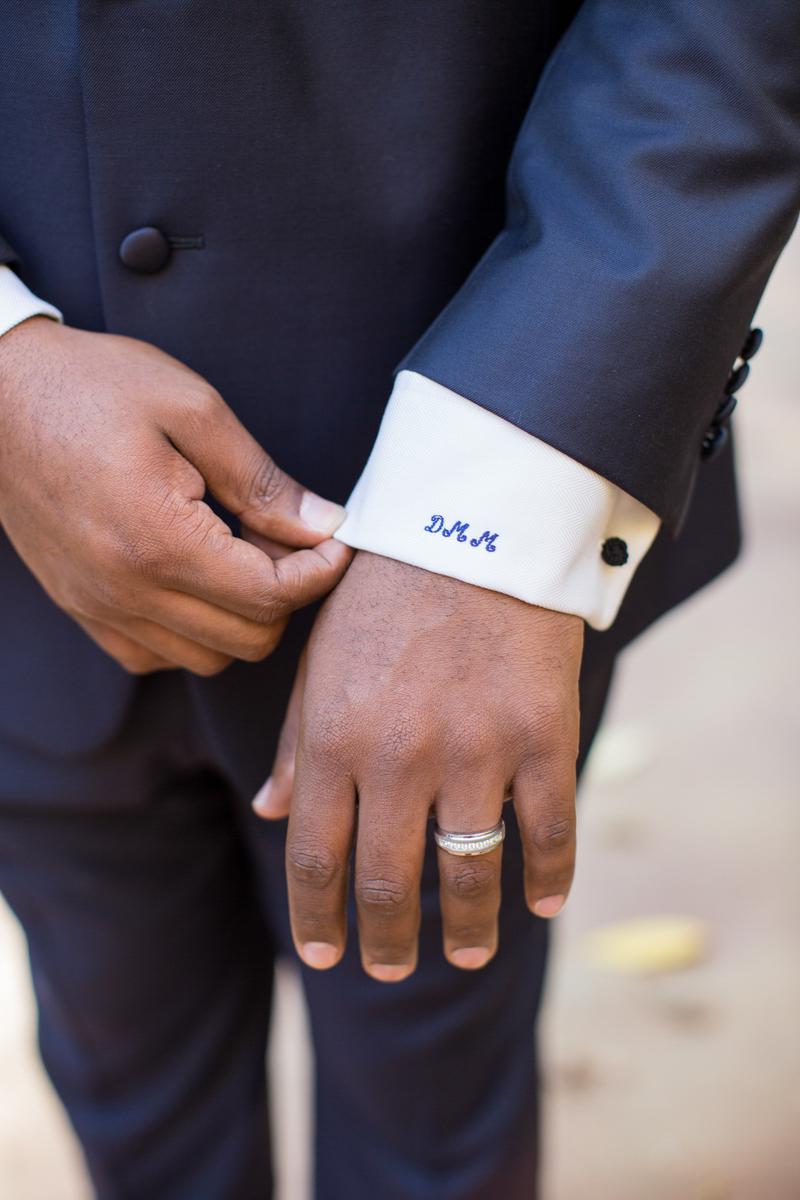 Monogrammed cuff on groom's shirt