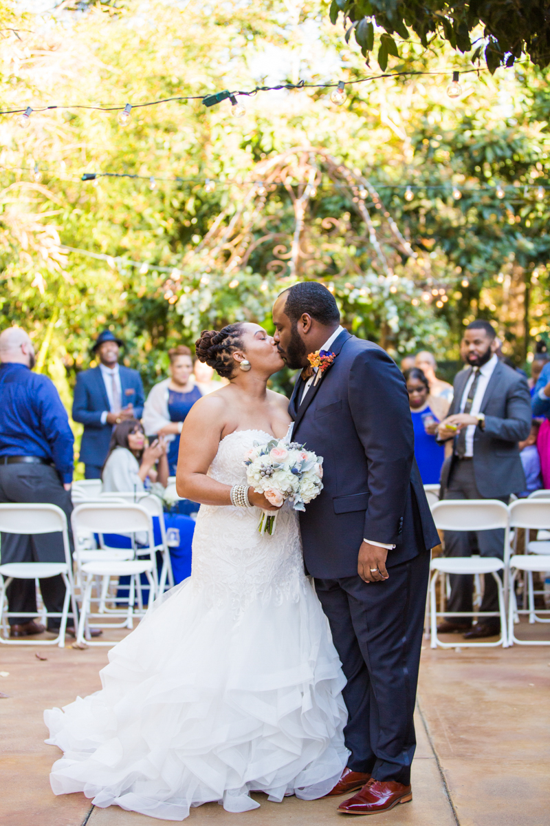 kissing while walking down the aisle
