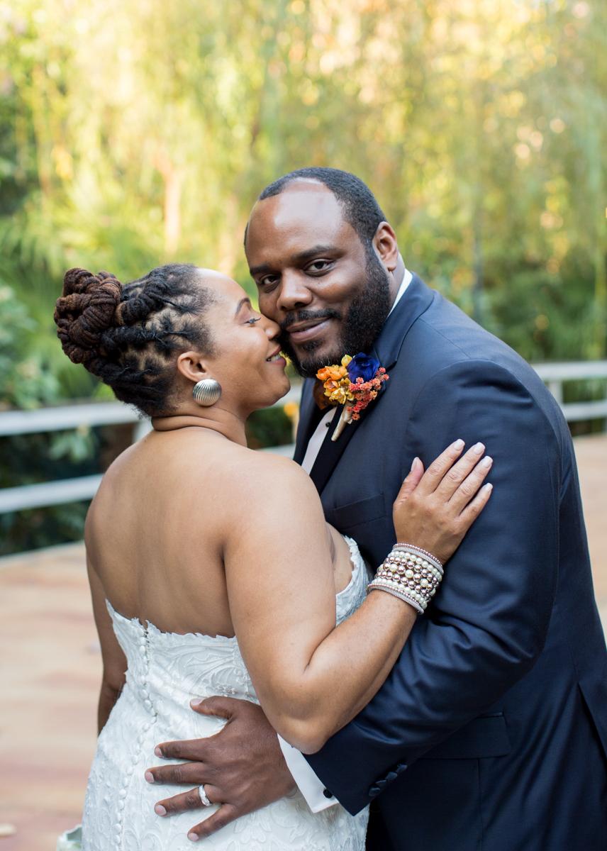 bride kissing groom's cheek