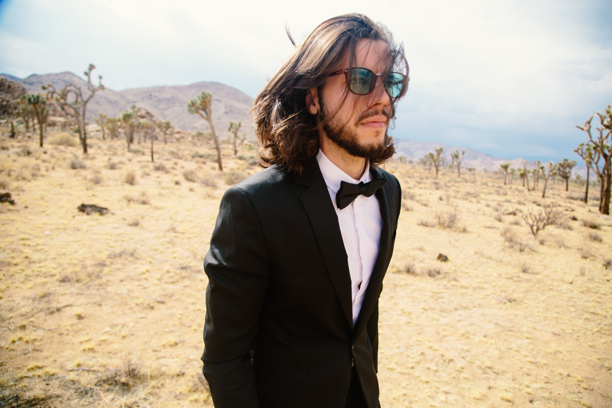 Very cool groom in a tuxedo in the desert