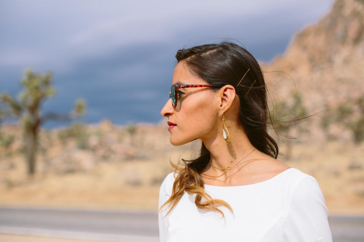 Hip bride in sunglasses in the desert