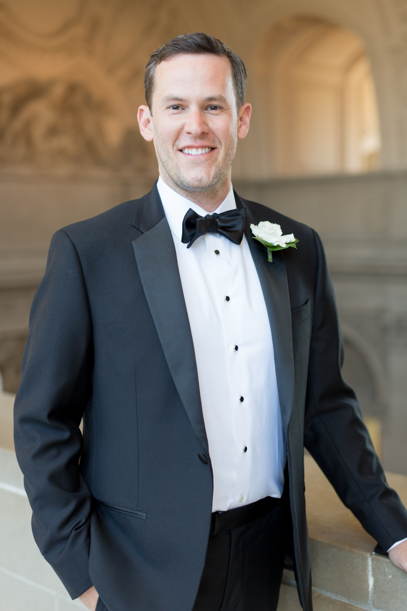 classic groom style in a tuxedo
