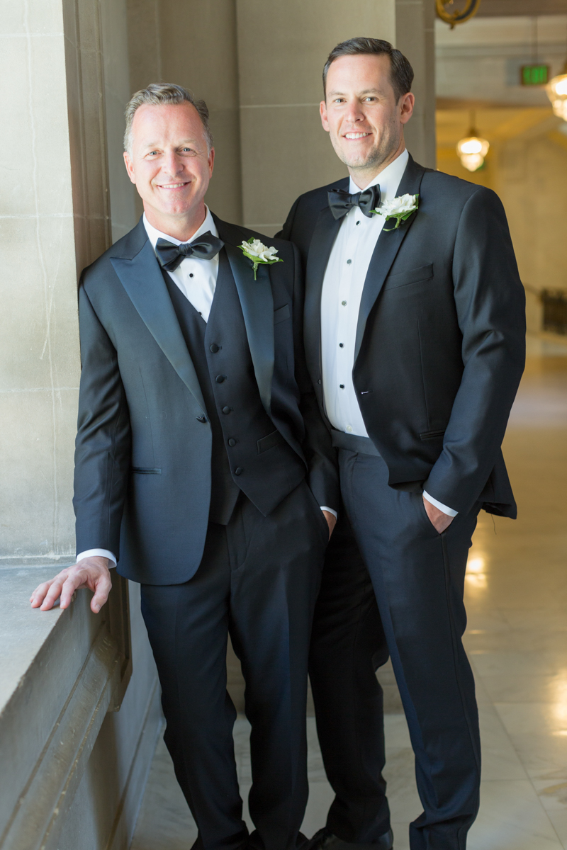 Grooms posed together