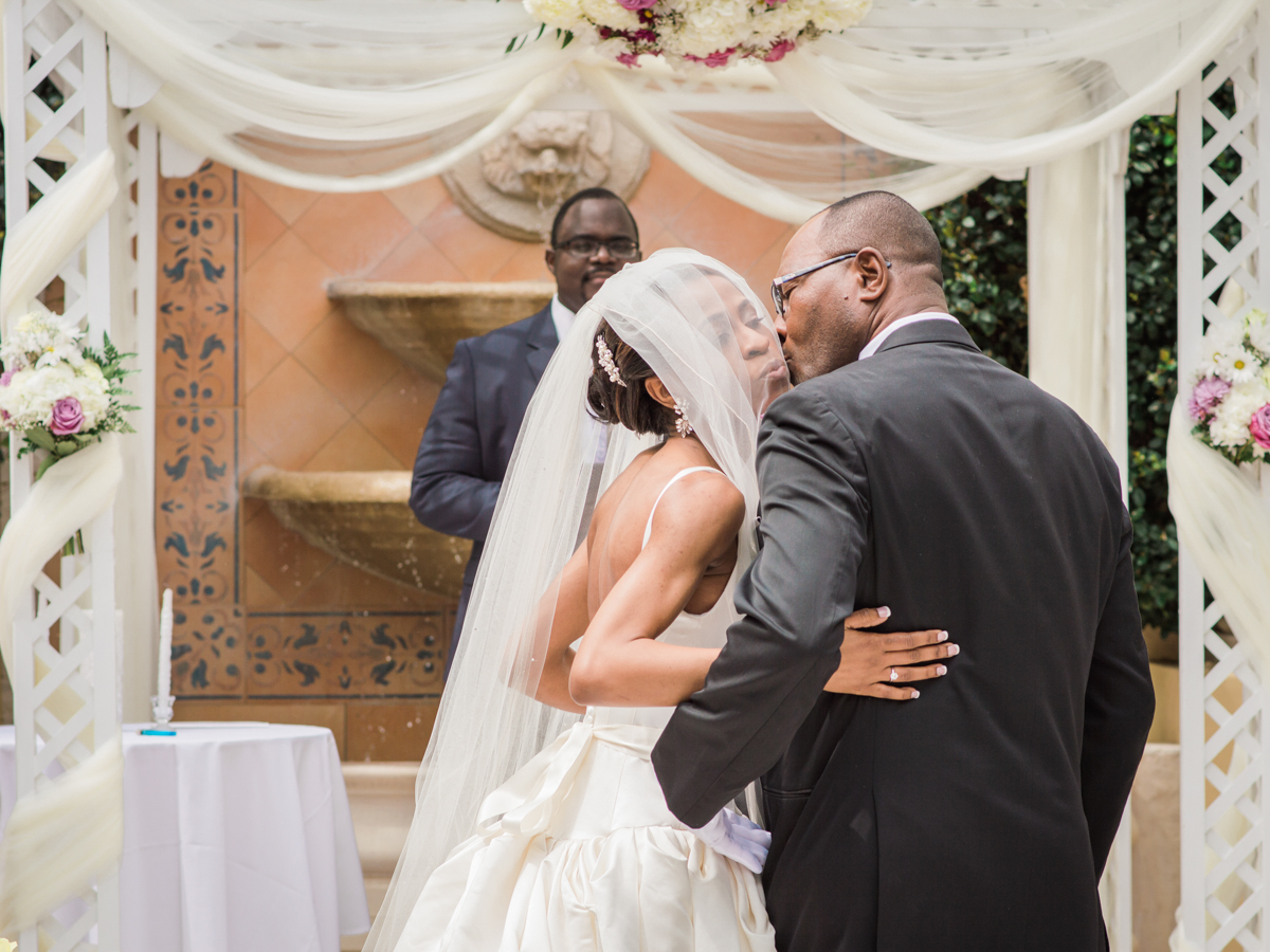 Bride hugging and kissing dad after walking down the aisle
