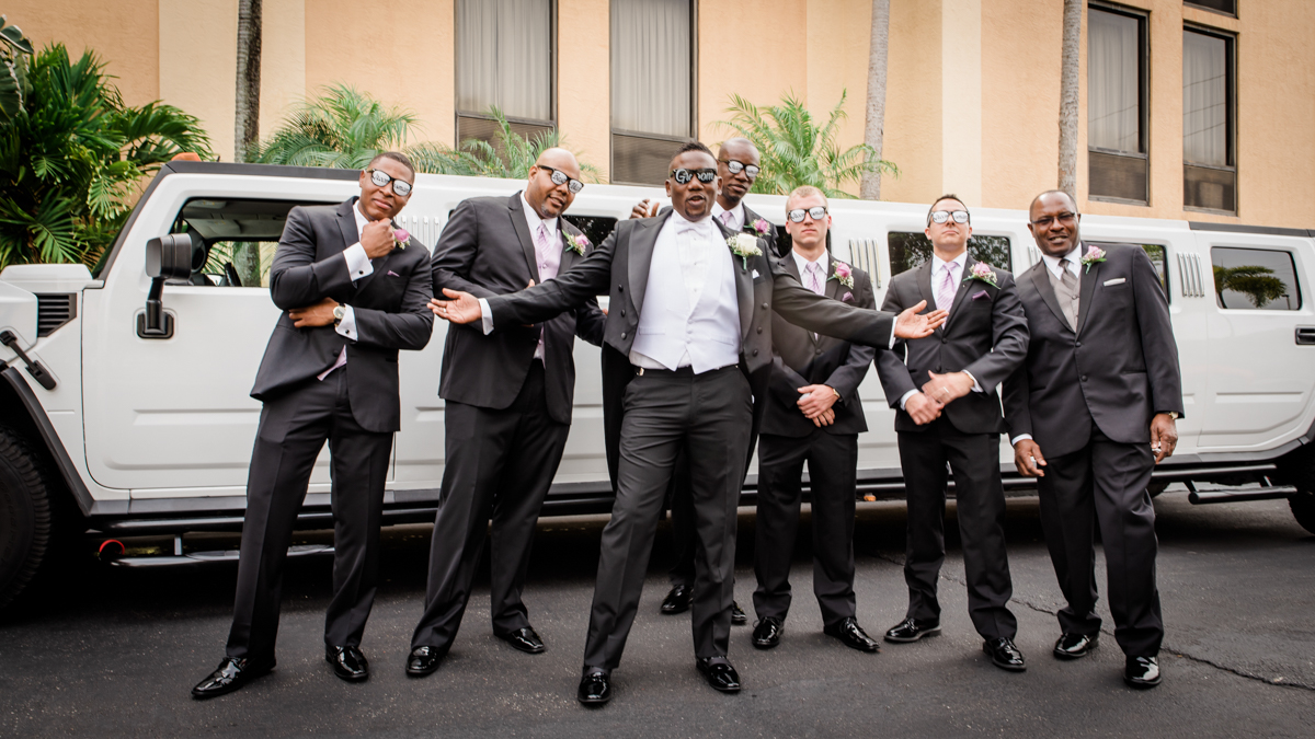 Groom and groomsmen with a stretch hummer
