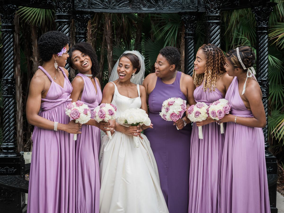 Bride and bridesmaids in purple satin