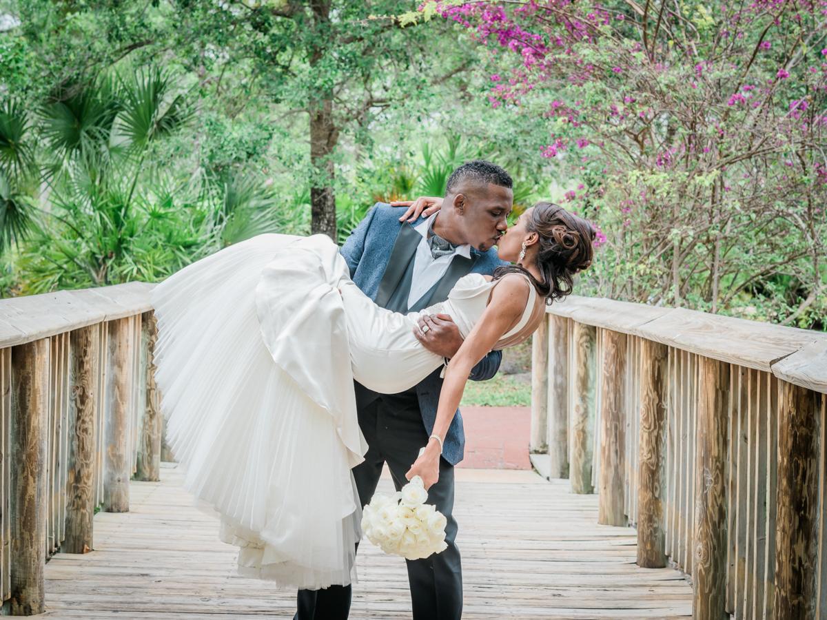 Bride being swept off her feet by groom