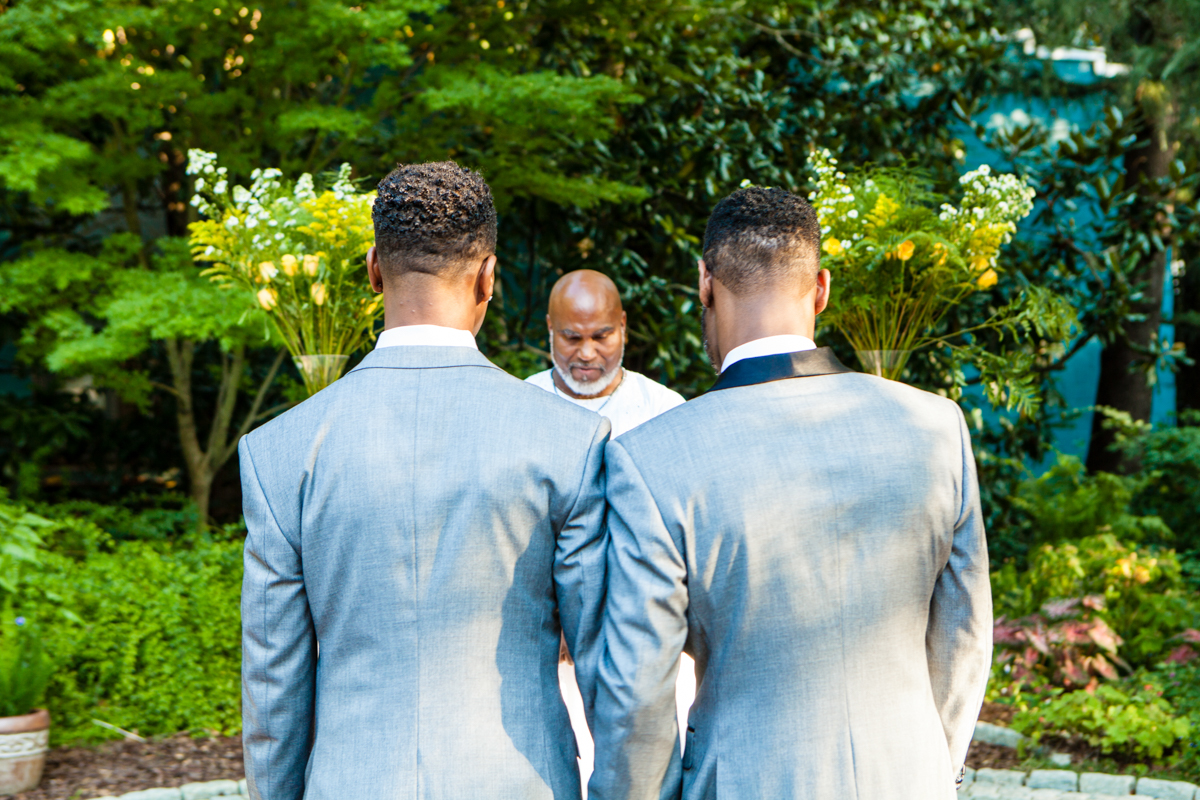 Grooms in bespoke tuxedos at their wedding ceremony