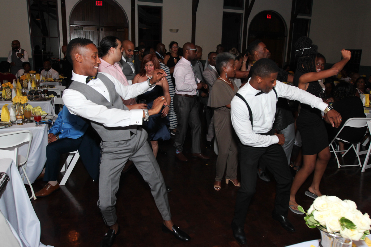 Grooms dancing at their wedding reception.
