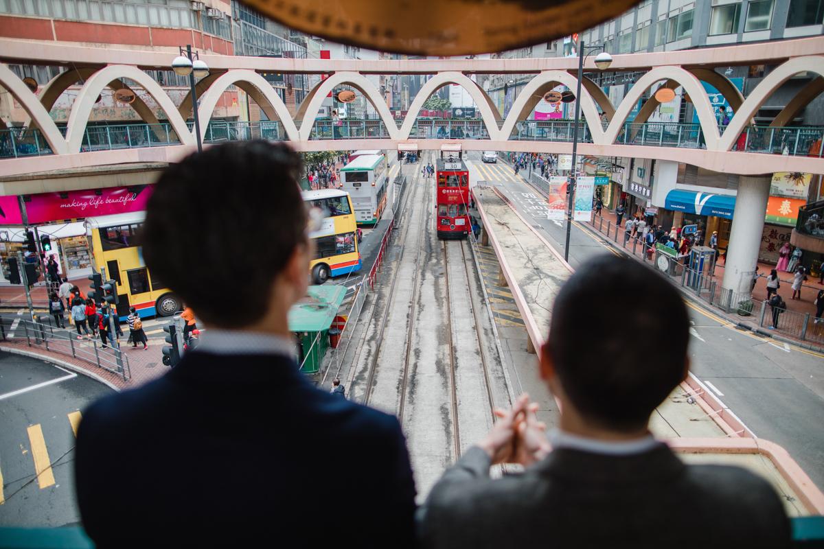 couple looking at the rail yards of Hong Kong