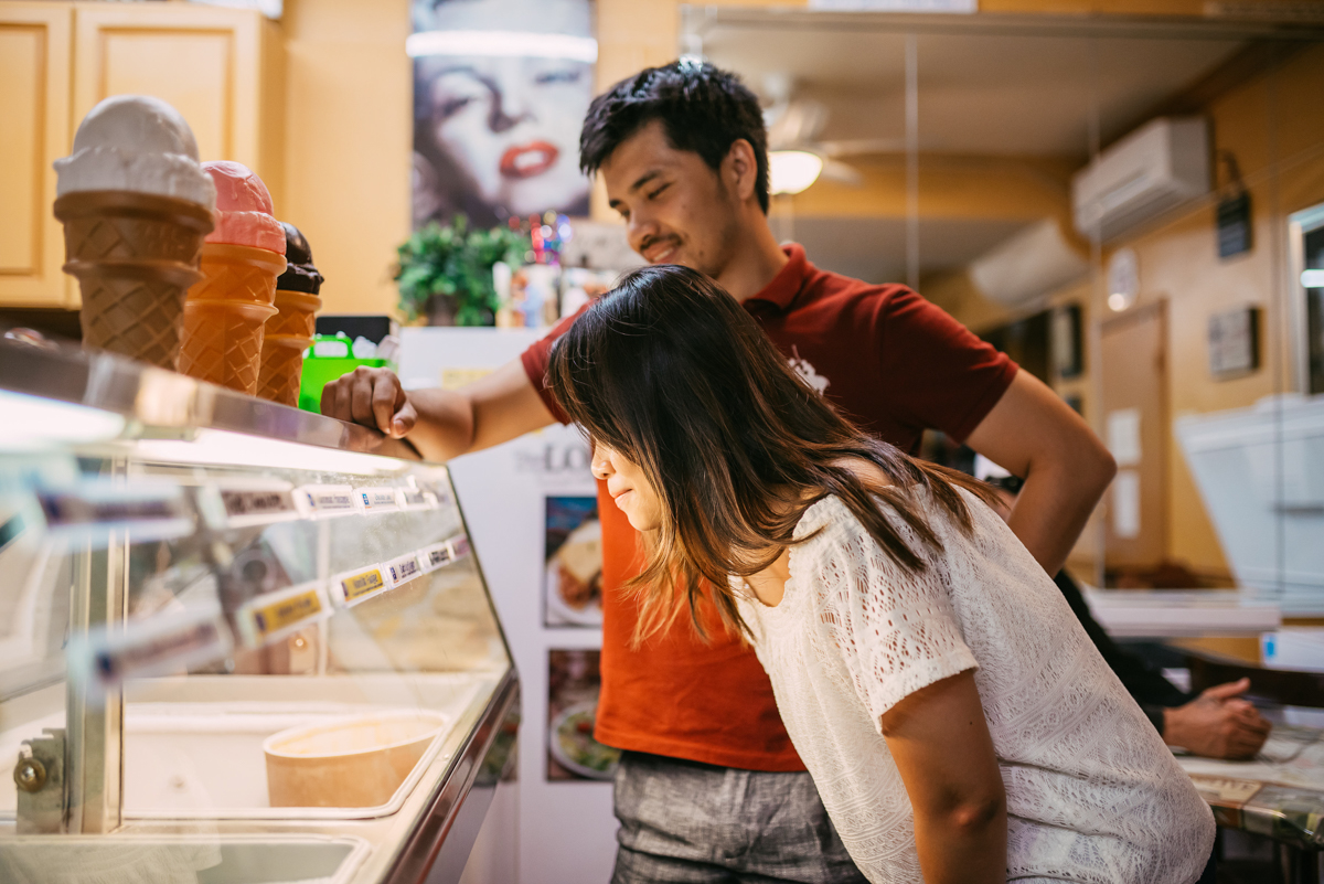 couple choosing ice cream at their engagement session