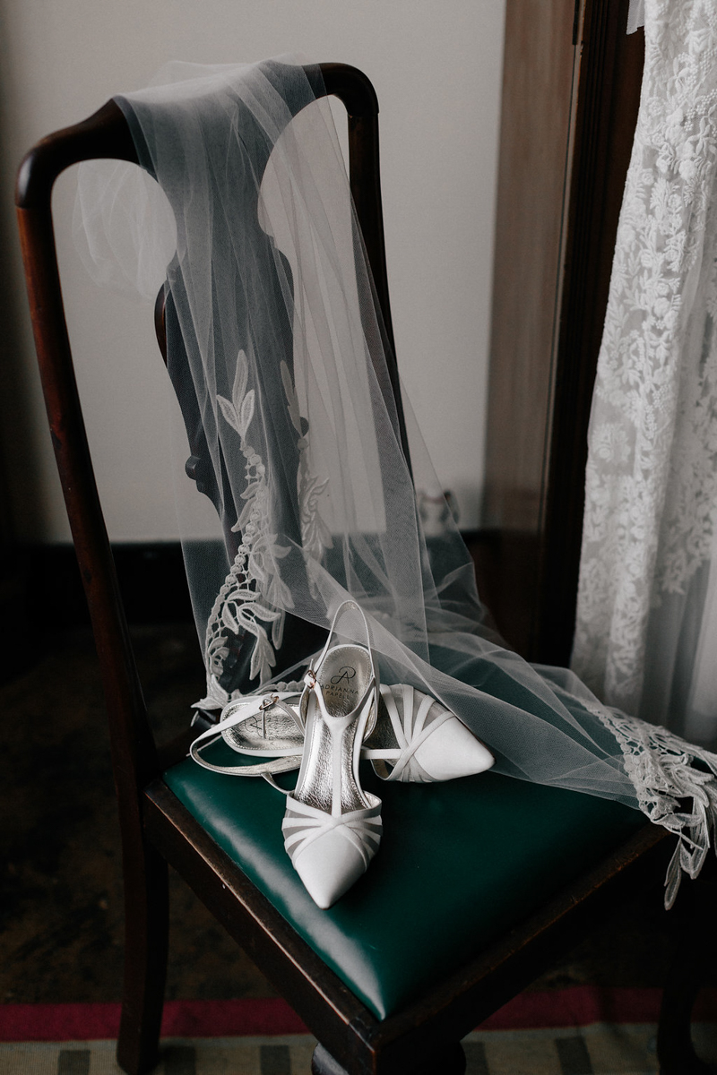 white bridal shoes on a chair