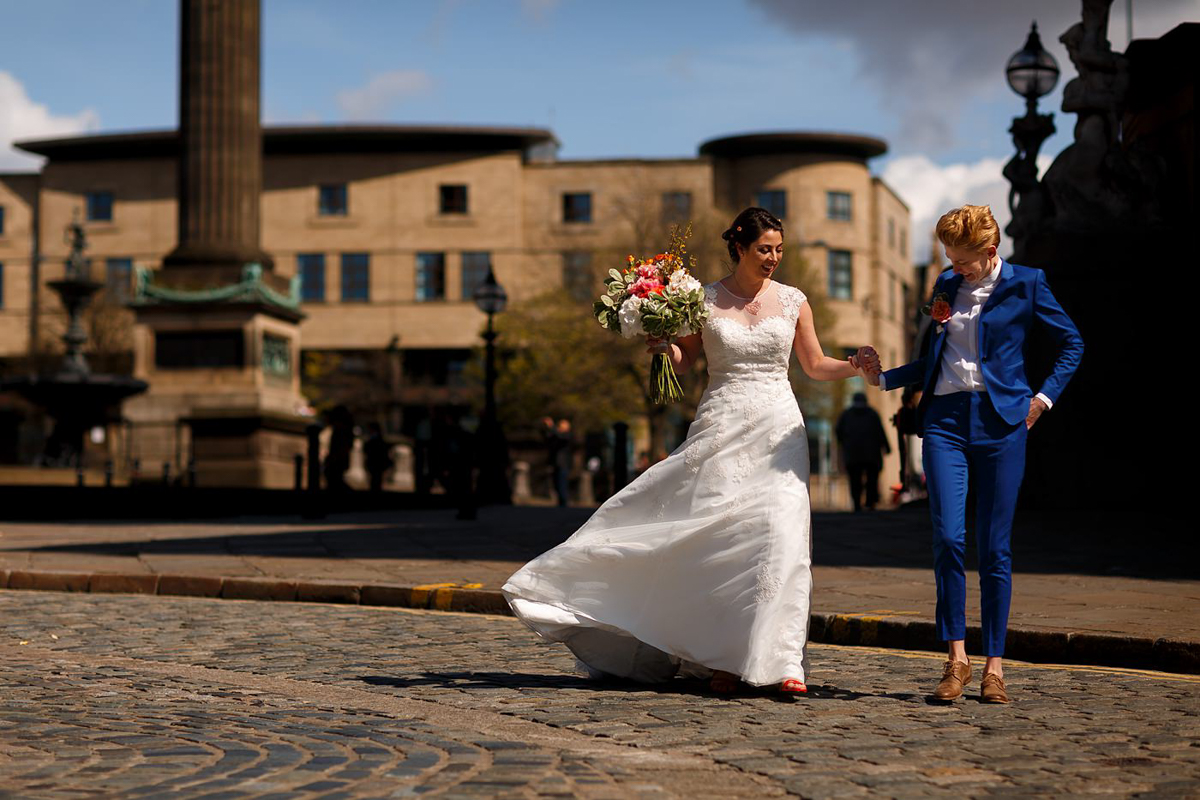 Brides on the street in Liverpool at their wedding