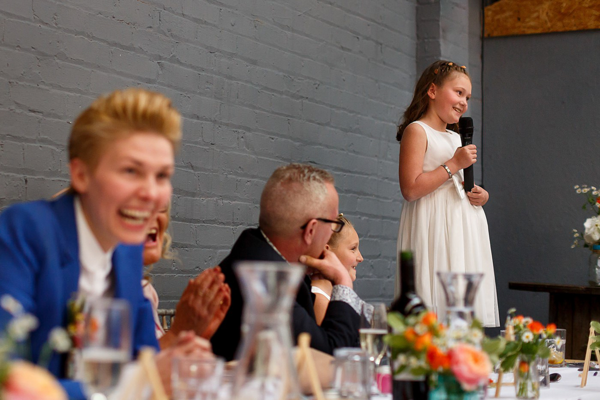 flower girl giving a speech