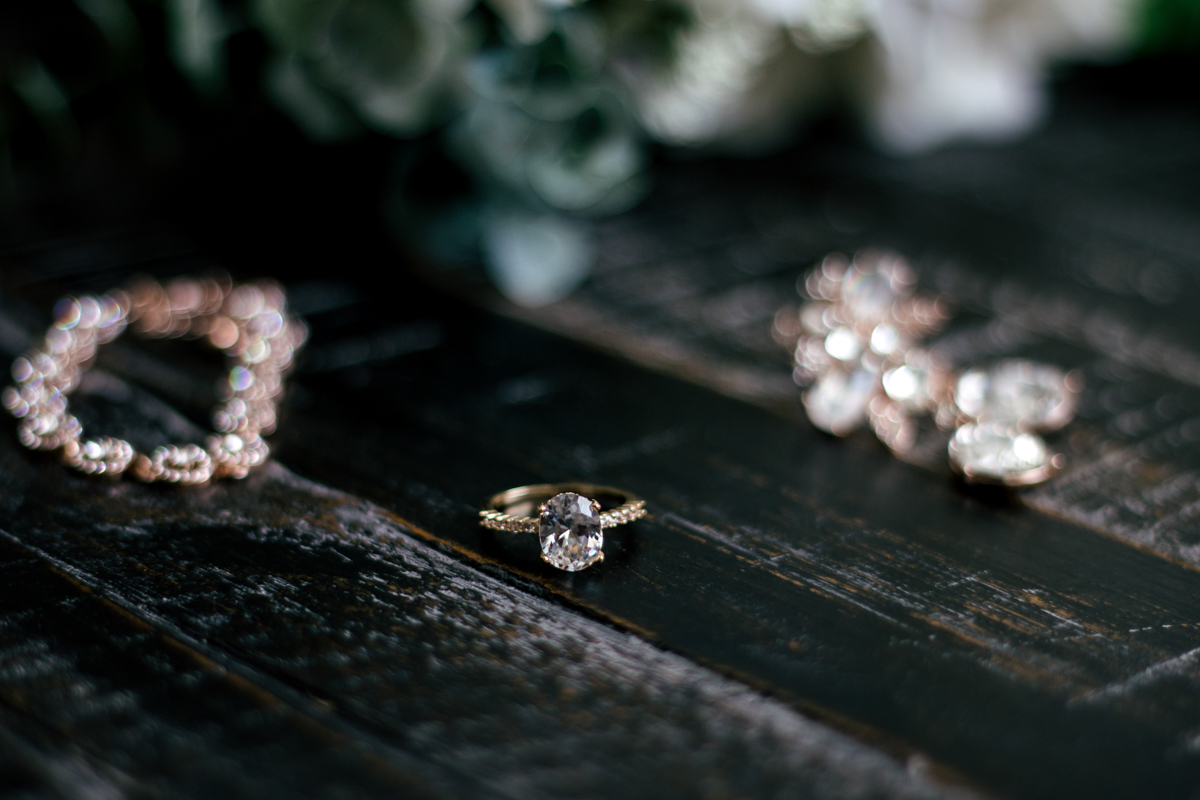 Bride's accessories laid out, including her oval cut ring