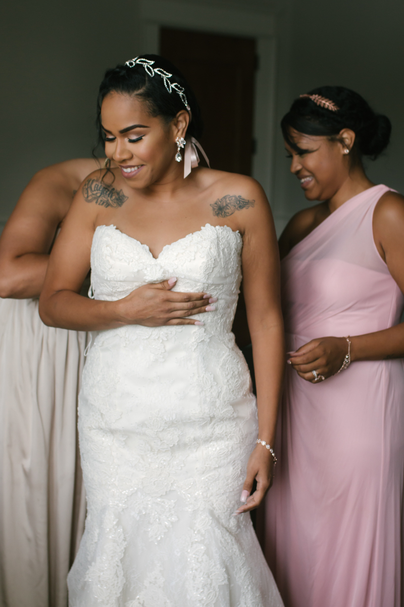 Bride being zipped up