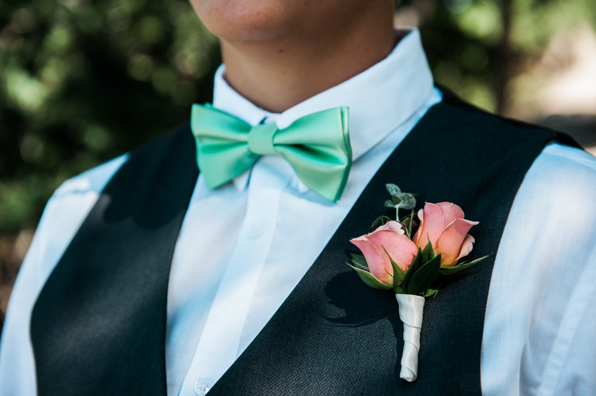 mountain elopement close on katie's lapel roses