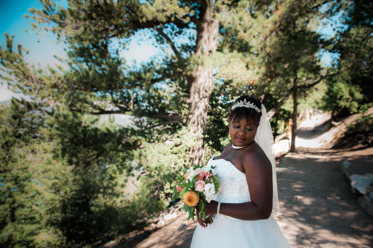 mountain elopement amber holding bouquet