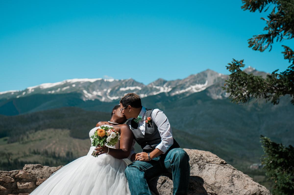mountain elopement kiss on rocks