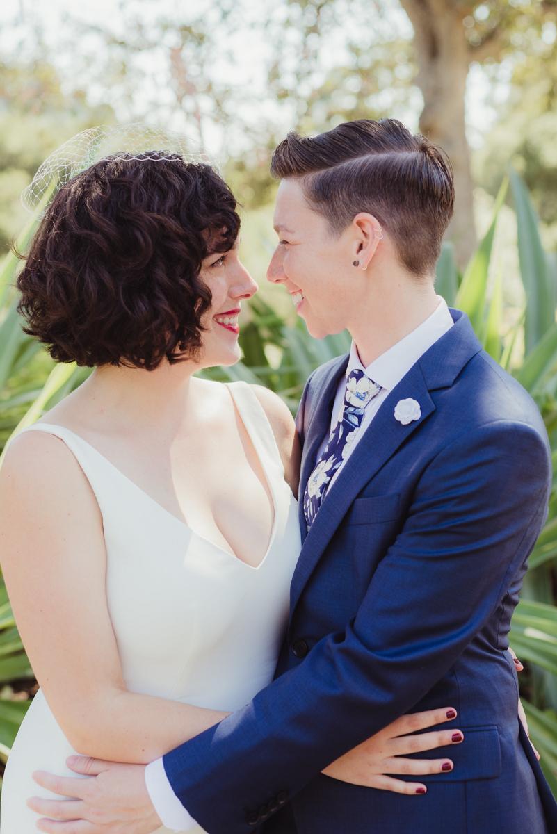 uc berkeley garden wedding couple embracing