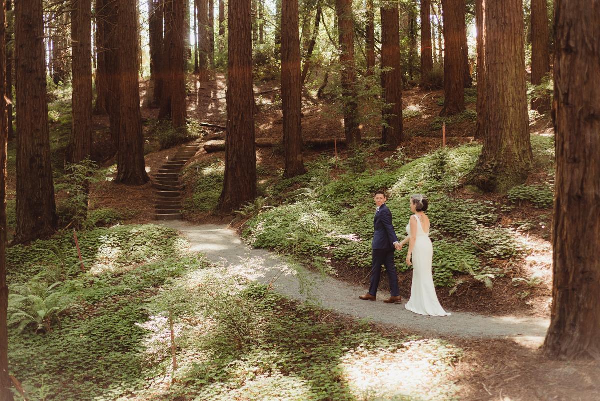 uc berkeley garden wedding couple walking on garden path