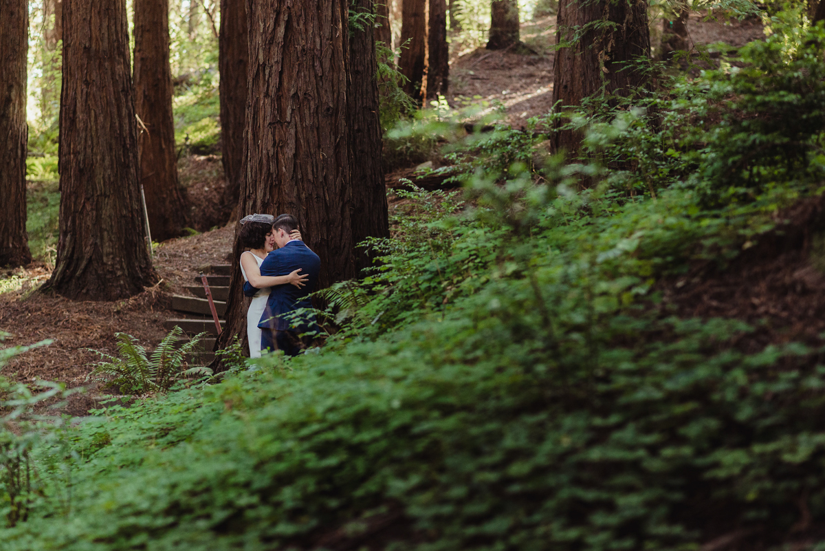 kiss by tree and shrubs