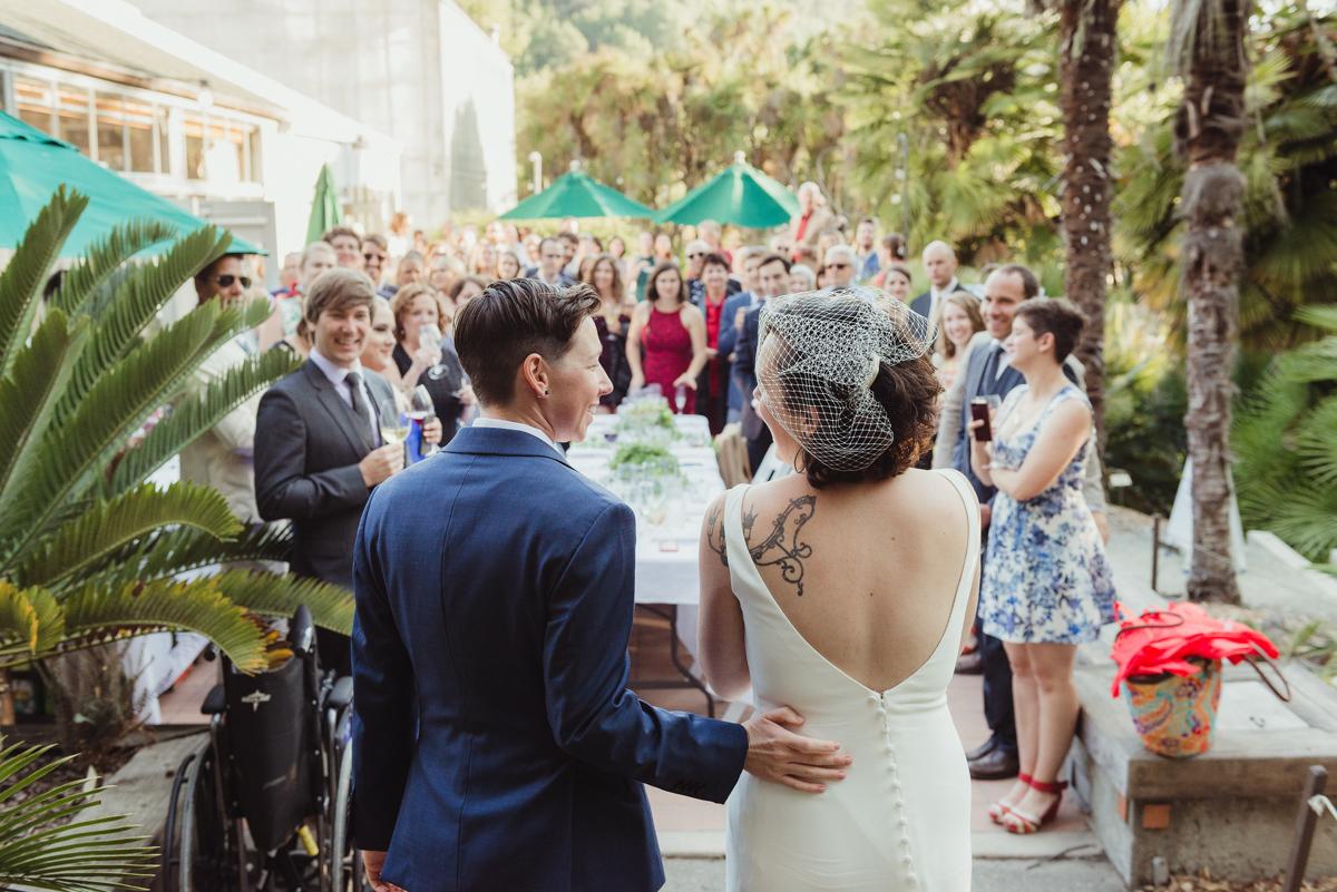 uc berkeley garden wedding couple entering reception