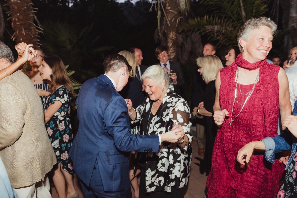 uc berkeley garden wedding lark and guest dancing