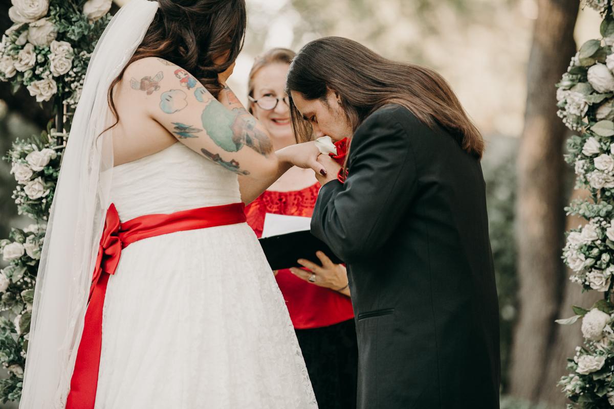 San antonio garden wedding mykel kissing orlando's hand
