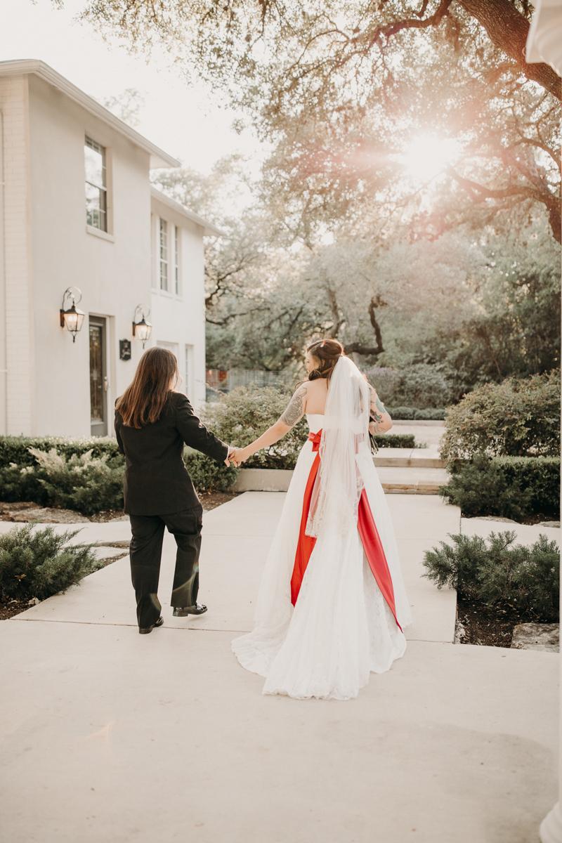 San antonio garden wedding holding hands walking