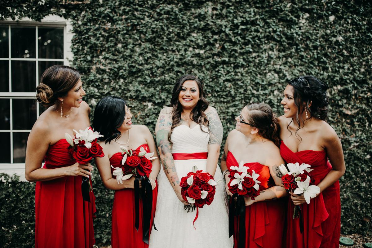 San antonio garden wedding bride between four bridesmaids