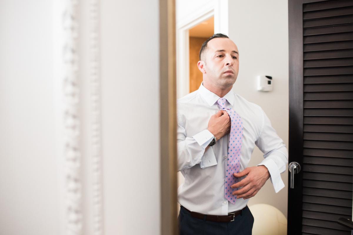 San Diego Museum of Art Wedding groom fastening tie
