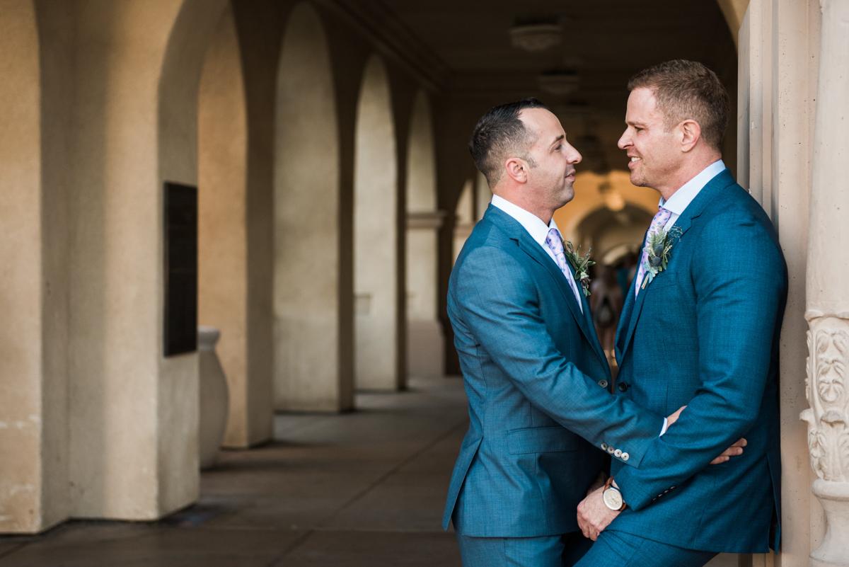 San Diego Museum of Art Wedding embrace in hallway