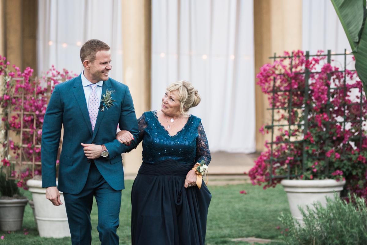 San Diego Museum of Art Wedding groom walking with mother