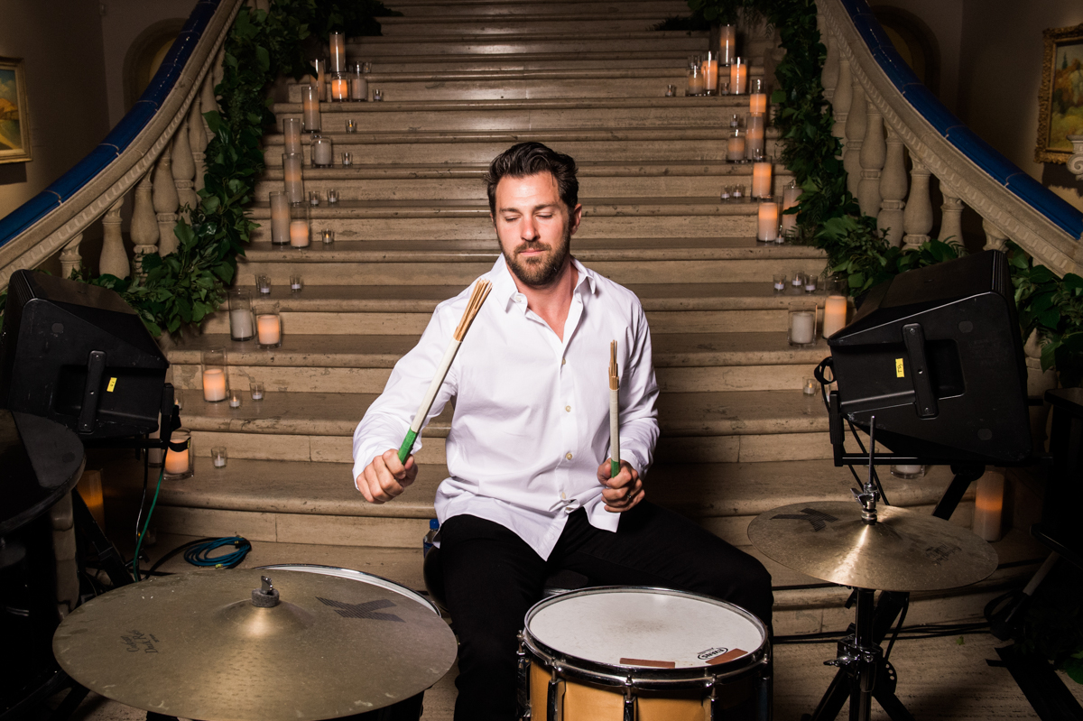 San Diego Museum of Art Wedding drummer playing in front of staircase