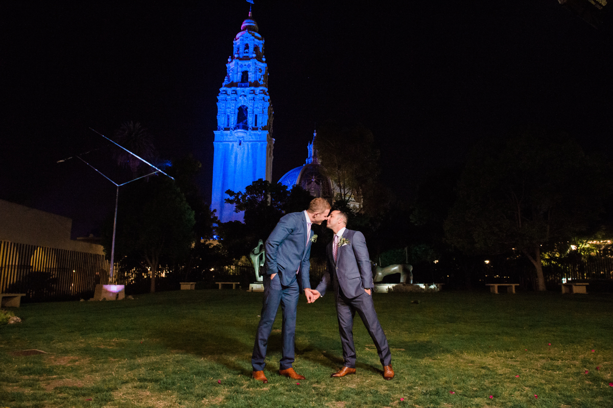 San Diego Museum of Art Wedding kiss on lawn outside lit museum