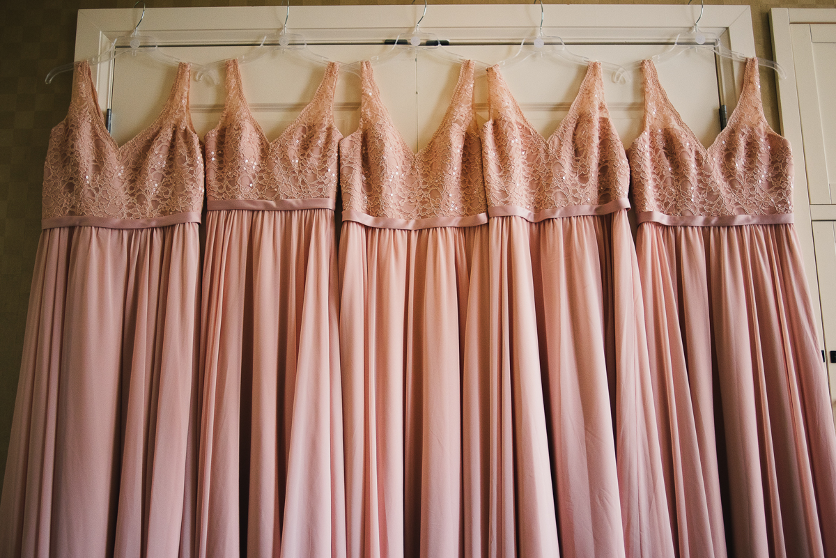mount vernon ballroom wedding bridesmaids' dresses hanging
