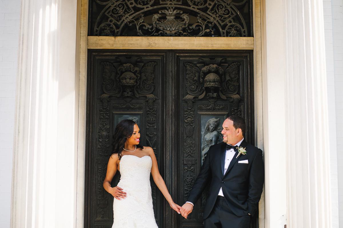 mount vernon ballroom wedding couple holding hands outside church doors